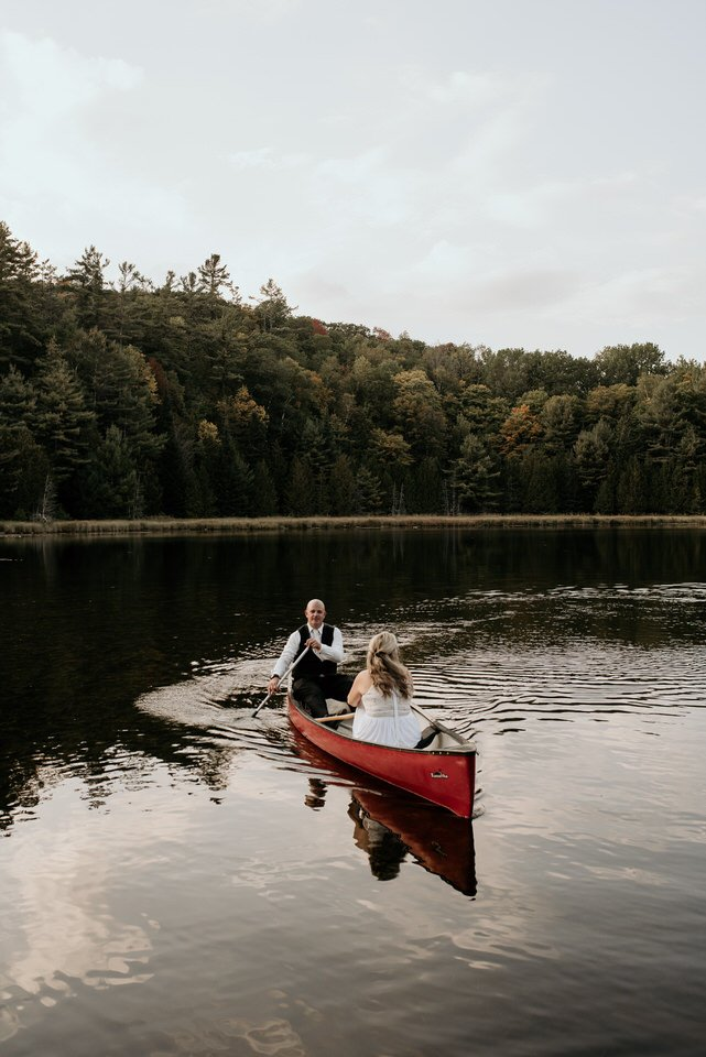 bride and groom canoeing on lake
