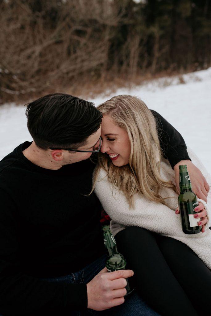 couple drinking beer cuddling